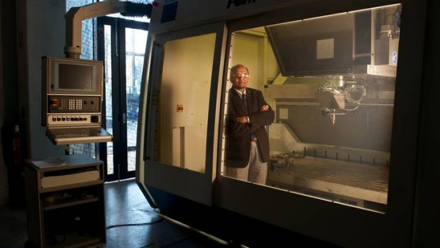 Professor Syed Masood in the Direct Metal Deposition machine at Swinburne University.