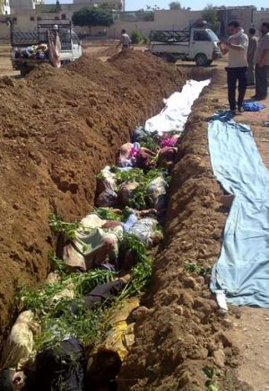 The most appalling incident yet ... bodies lie in a shallow grave in Darayya.