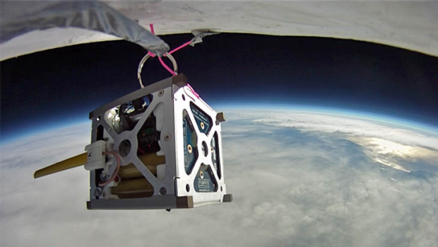 NASA plans to launch three smartphone nanosatellites later this year. Above is the PhoneSat 1.0 during a high-altitude ...