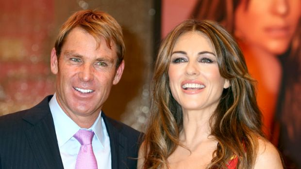 On the move ... Shane Warne and Liz Hurley.