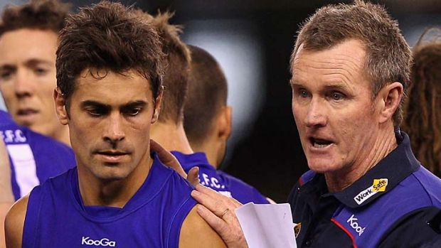 Not over yet: Injured Bulldog Daniel Giansiracusa, with coach Brendan McCartney, is likely to play on next season.