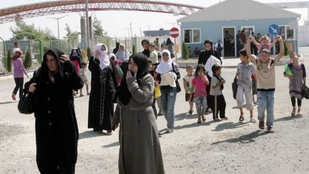 Syrian refugees arrive at the Oncupinar refugee camp in Kilis near the Syrian border. The swelling numbers of refugees ...