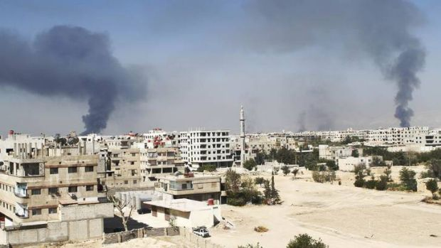 Smoke rises from Damascus suburbs of Ain-Terma, during clashes between Syrian rebels and pro-government forces.