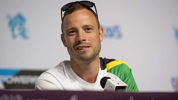 South Africa's double-amputee runner Oscar Pistorius talks to the media at a press conference yesterday.