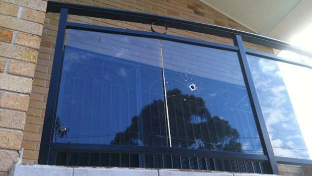 A  bullet hole in the window of a family home in Auburn across the road from where the boy was shot.