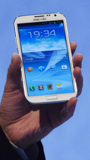 Jean-Daniel Ayme, vice president European Telecom Operations at Samsung, holds a new Galaxy Note II at the Samsung event ...