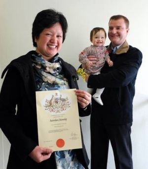 Ella Hallock got her certificate with a happy husband Grant and baby daughter Grace there in support.