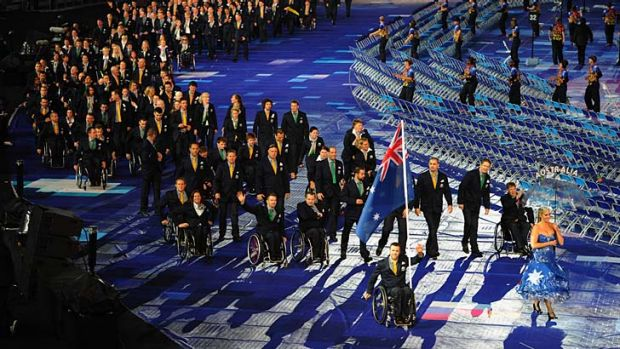 Passion and pride: Wheelchair rugby player Greg Smith carries the flag for the Australian team during the opening ...