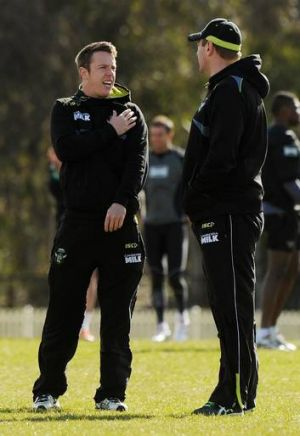 Raiders halfback Sam Williams points out his troubled shoulder to Canberra coach David Furner at training yesterday.