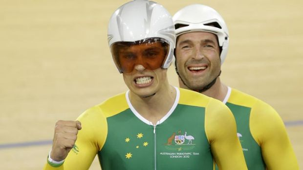 Scott McPhee, left and partner Kieran Modra of Australia celebrate after winning the gold medal in the Men's Individual ...