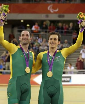 Kieran Modra (left) and riding partner Scott McPhee celebrate their gold medals for the Men's Individual B Pursuit at ...