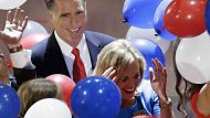 Republican presidential nominee Mitt Romney watches as balloons fall around him and his wife