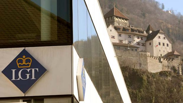 Historic haven: The logo of the LGT Group in Liechtenstein stands in sharp contrast to Vaduz Castle, home of the royal ...