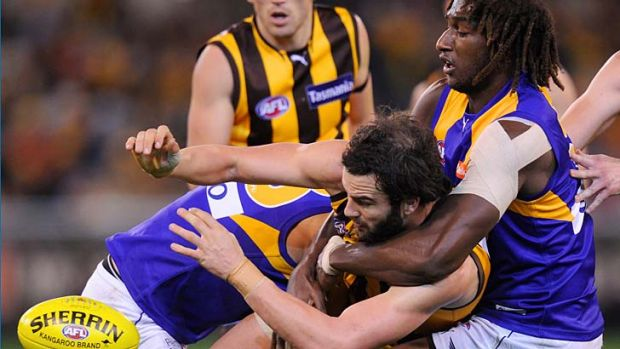 Hawthorn's Jordan Lewis is tackled by Nic Naitanui.
