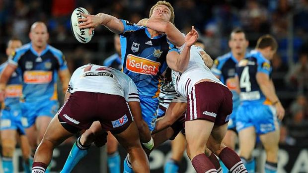 Flick and hope ... Luke O'Dwyer gets the ball away despite a lot of attention from the Sea Eagles.