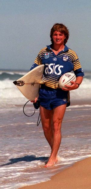Surfy kid made good ... Parramatta winger Luke Burt takes a stroll on the beach in the lead-up to his NRL debut in 1999.