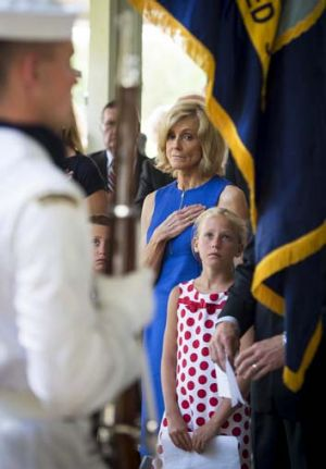 Hero … Armstrong's widow, Carol, and granddaughter, Piper Van Wagenen, during the service.