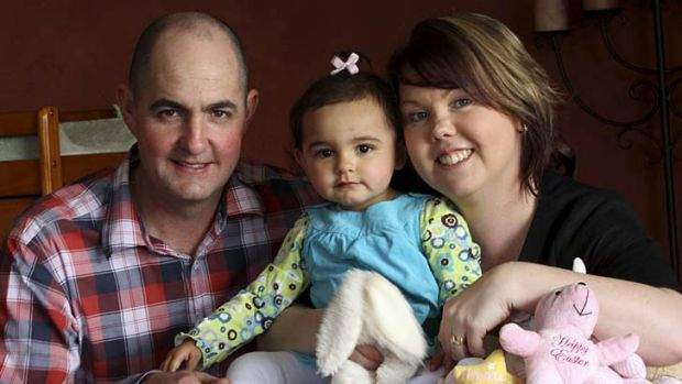 Overcoming the distance … Michael and Candice Wylie with their daughter, Mackenzie.