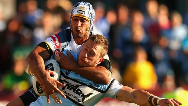 Johnathan Thurston of the Cowboys tackles Nathan Stapleton of the Sharks.
