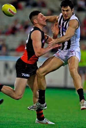 Chris Tarrant, seen here being put under pressure by Bombers rookie Michael O'Brien in a marking contest, believes the ...