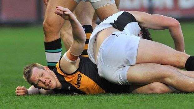 Look at me: Jack Riewoldt appeals to the umpire after colliding with Port's Jarrad Redden.