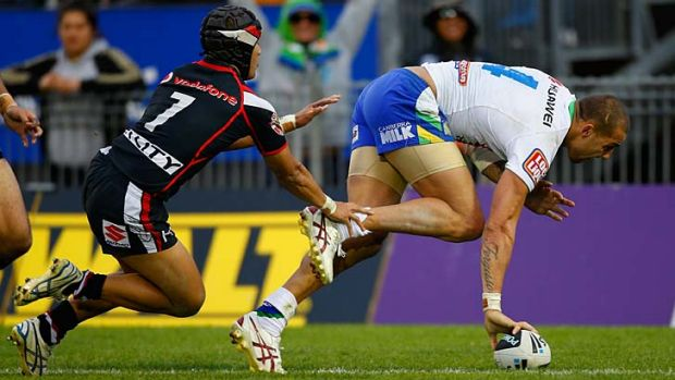 Trying time ... Blake Ferguson goes over in Canberra's 42-22 win over the Warriors.