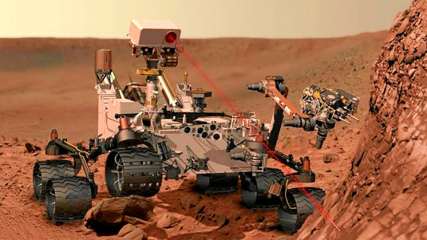 This artist's concept depicts the rover Curiosity, of NASA's Mars Science Laboratory mission, as it uses its Chemistry ...