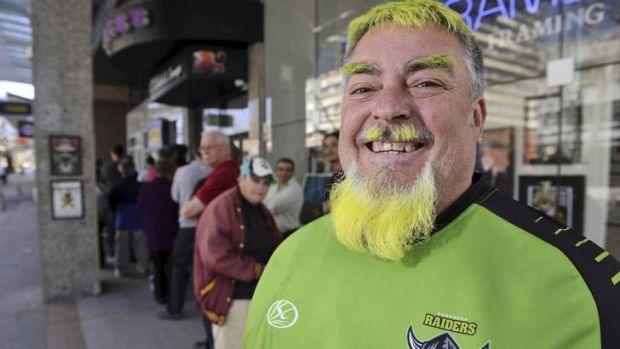 Raiders supporter Mick Lennon lines up for tickets to Sunday's elimination final against the Cronulla Sharks at Canberra ...