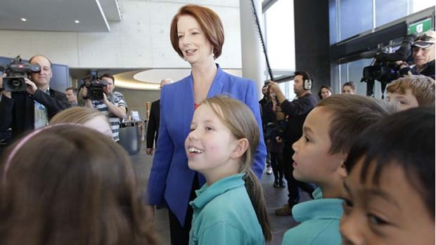 Prime Minister Julia Gillard met school students at the National Gallery of Australia before she addressed the National ...