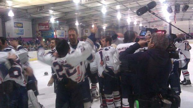 Ice players celebrate after winning the Goodall Cup, watched closely, as always, from the documentary crew producing a ...