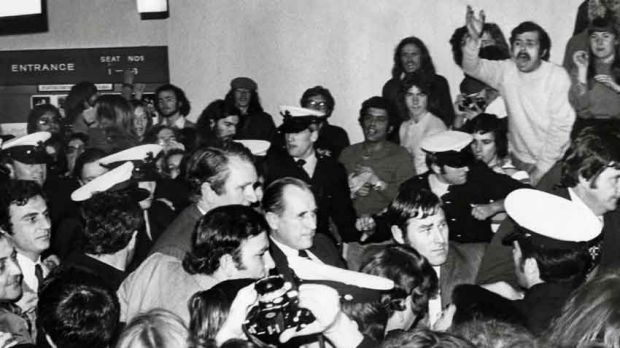 Caught in the crush: Malcolm Fraser surrounded by police and protesters.