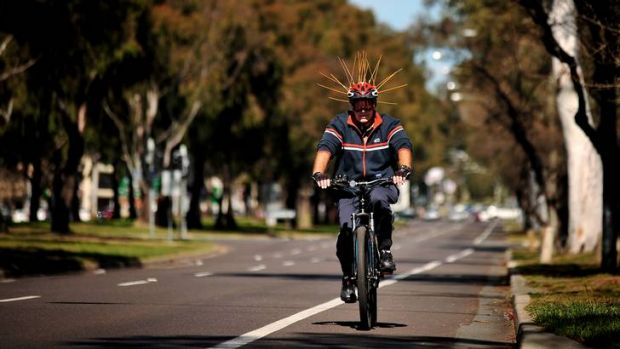 A cyclist along Northbourne Ave today takes the scaring of magpies away to the extreme.