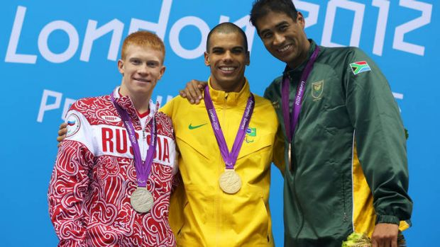 Achmat Hassiem on the podium with his bronze medal.