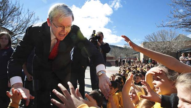 Kevin Rudd, during his time as PM,  being welcomed by students from Gordon Primary School in the ACT.