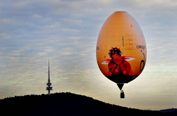 Cirque Du Soleil's OVO Hot air balloon flies over the Australian Capital.
