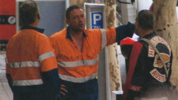 Building relations? Grocon safety managers Peter Hewett (left) and Daniel Van Camp talk to a Hells Angel bikie at the ...