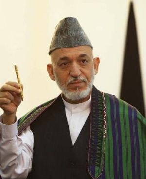 Hamis Karzai's administration denies claims that permission was given for an SAS raid.