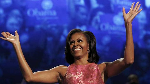 Michelle Obama waves to the crowd at the first session of the Democratic National Convention in Charlotte.
