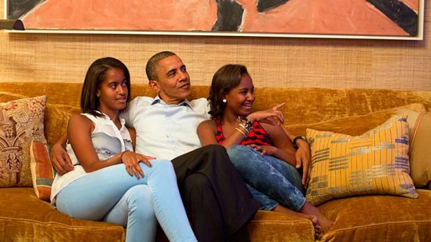Fan base ... Barack Obama and his daughters, Malia, left, and Sascha, watch the first lady deliver her speech.