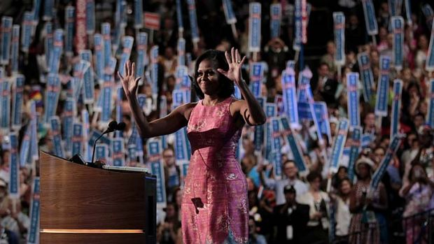 Preaching to the choir ... Michelle Obama waves to supporters after delivering her speech at the Democratic National ...