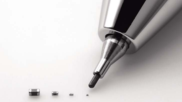 Murata's latest capacitor, measuring just 0.25 millimeter by 0.125 millimeter, right, is pointed by a mechanical pencil ...