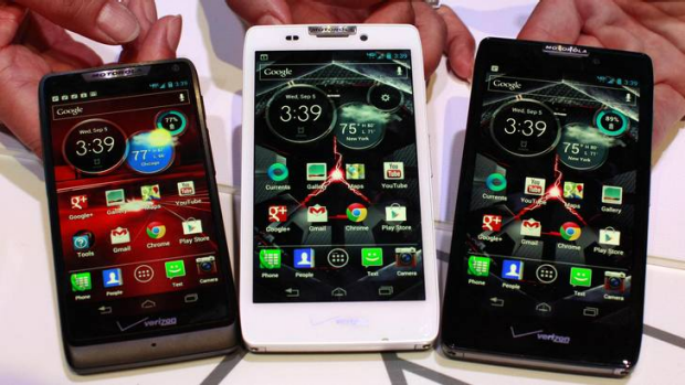 Product specialists display new Motorola droid phones; (L-R)  Razr M, Razr HD and Razr Maxx HD during a launch event in ...