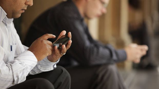 New dangers ... a survey found that 81 per cent of adults don't use a security solution on their mobile phone, such as a ...