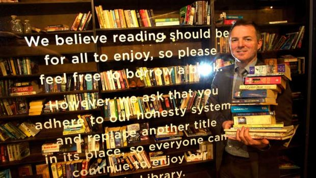 Melbourne Central's Justin Shannon in the Little Library at the shopping centre that operates on an honour system.
