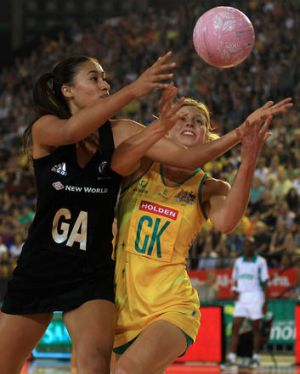 Arch-rivals:  Maria Tutaia (left) of New Zealand contests with Laura Geitz of Australia.