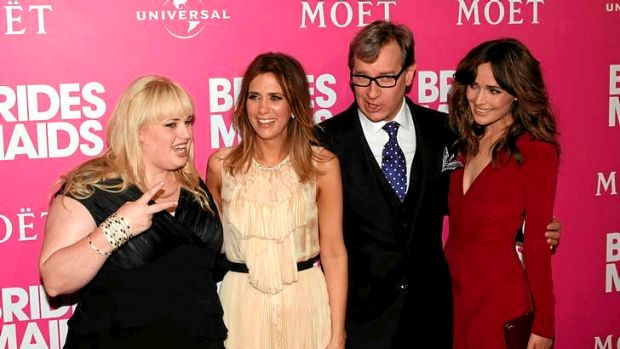 Rebel Wilson (left) with fellow Bridesmaids cast members Kristen Wiig and (far right) Rose Byrne and director Paul Feig ...