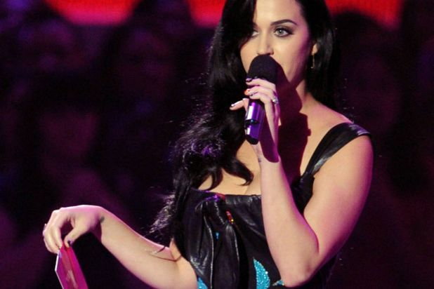 Singer Katy Perry speaks on stage.