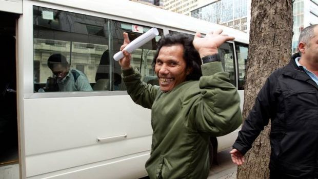 Sawal Eik leaves the County Court yesterday after 16 Indonesians were granted bail or had their bail extended.