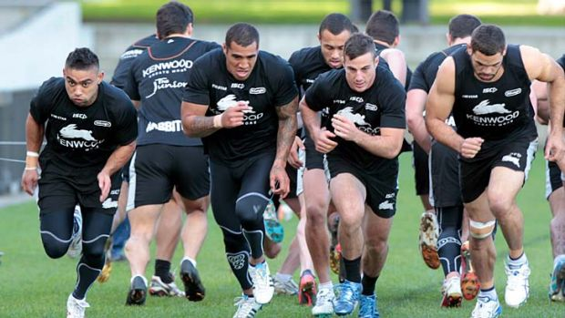 Run rabbits, run ... Souths train at the refurbished Redfern Oval.