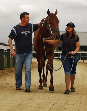 New Zealand trainer Shaune Ritchie, seen here with his fiancee Alison Bremner and his Cox Plate entrant Magic Cape in ...